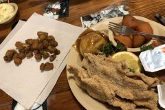 Catfish with candied yams, mashed potatoes, and fried okra.