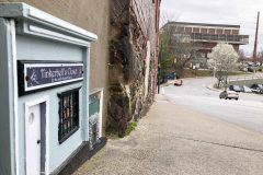 A pixie-sized shopfront standing no more than six inches high from the sidewalk