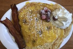 Cranberry pancakes with orange curd. The bacon made it a balanced meal.