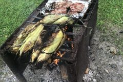 Grilling corn and chops at the campsite